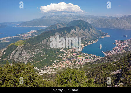 Looking down onto the town and Bay of Kotor with cruise ships 'Regal Princess' and 'Celebrity Silhouette' moored - Stock Photo