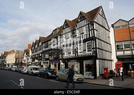Row of tudor buildings on High Street in Stratford Upon Avon town centre - Stock Photo