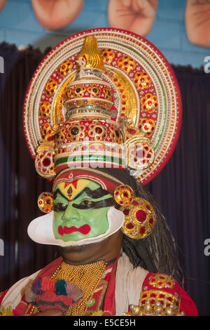 Actor in Kathakali, Kerala's classical dance-drama, wears heavy makeup (green face shows hero) as well as elaborate - Stock Photo