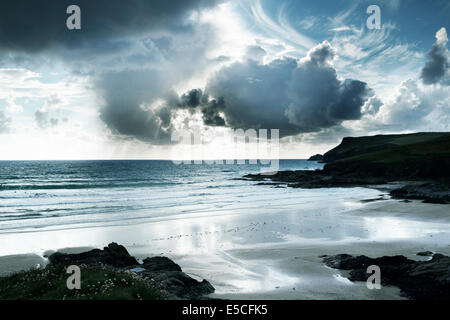 stunning polzeath beach in cornwall england with dramatic late afternoon light - Stock Photo