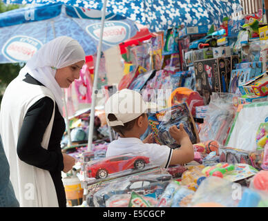 A mother and son at the open market in the old city of Nazareth, Israel - Stock Photo