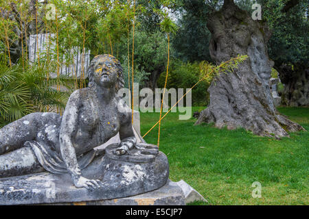 Stone woman statue in the garden of Bacalhoa Winery, Azeitao, Setubal Peninsula, Lisbon Coast, Portugal, Europe - Stock Photo