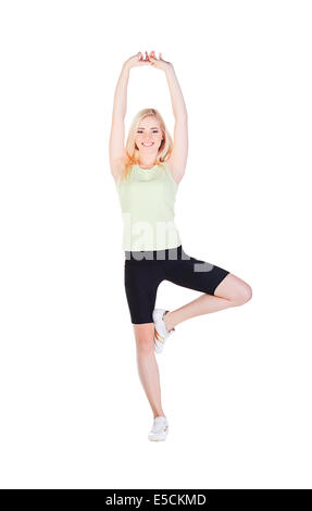 beautiful blonde girl in shorts doing aerobics isolated