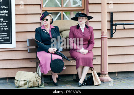 Two ladies taking part in a 1940s weekend at Bewdley Station, Worcestershire, UK, on the Severn Valley Railway, - Stock Photo