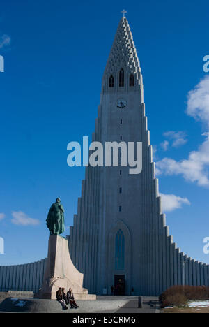 Hallgrimskirkja, Reykjavik's Cathedral based on natural basalt formation, with a statue to Leif Ericsson, Reykjavik, - Stock Photo