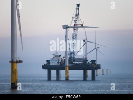 Sea Jack installing turbine blades on Gwynt y Mor Wind Farm off the coast of North Wales during the Construction - Stock Photo