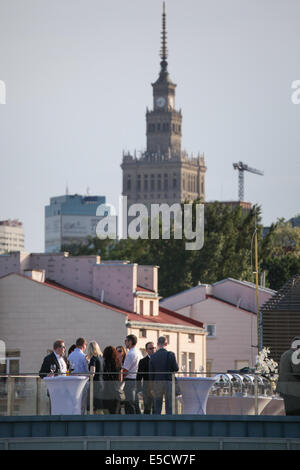 Guests at a wedding in Poland taking place on the rooftop of a building. The Palace of Science and Culture is in - Stock Photo