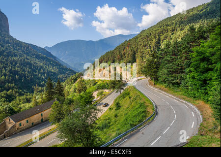 Narrow alpine highway on French-Italian border in Alps, France (view from above). - Stock Photo