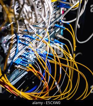 Fiber-optic equipment in a data center - Stock Photo