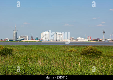 Skyline of Bremerhaven and Weser river - Stock Photo