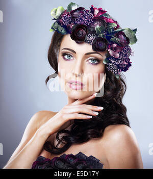 Valentine. Woman in Colorful Wreath of Flowers - Stock Photo