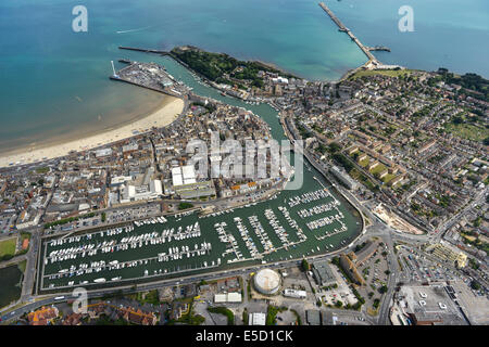 A wide aerial view of Weymouth showing the town, marina, Nothe Fort and harbour breakwater in Dorset, UK. - Stock Photo