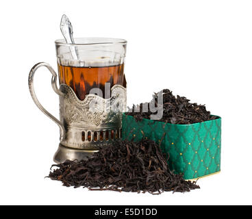 dry tea leaves in a box and glass - Stock Photo