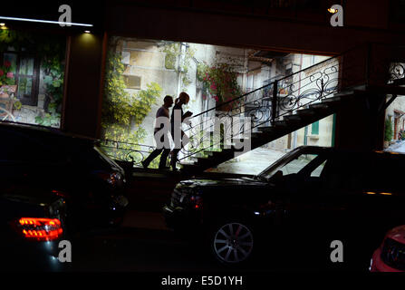 A couple walks on a narrow staircase leading towards a restaurant in the Armenian capital of Yerevan, Armenia, 27 - Stock Photo