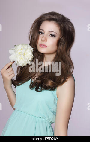 Sincere Gentle Meek Woman with Peony Flower - Stock Photo