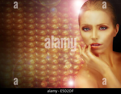 Fantasy. Beautiful Woman over Sparkling Gold Background - Stock Photo