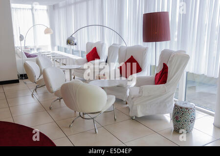 White chairs in a hotel lobby - Stock Photo