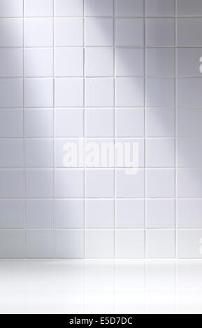 A vertical shot of a white tiled background or bathroom - Stock Photo