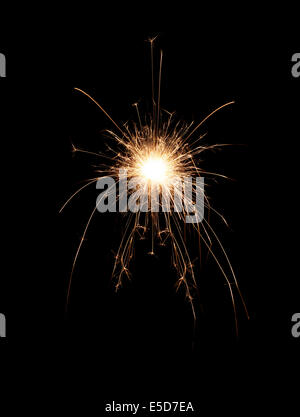 A spark on a black background - Stock Photo