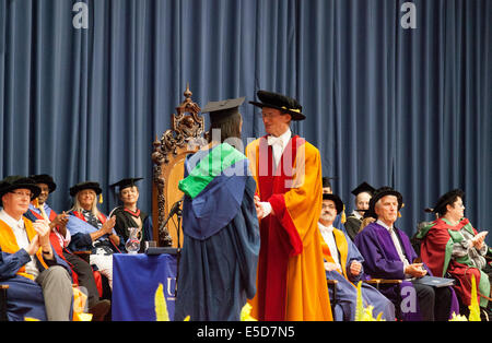 A graduating student receiving her degree at her degree ceremony, UEA ( University of East Anglia ); Norwich UK - Stock Photo