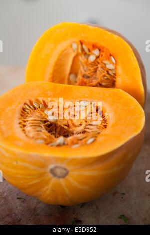 Pumpkin,Squash-cut in half,Cucurbita Pepo - Stock Photo