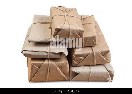 pile parcel wrapped with brown kraft paper isolated - Stock Photo