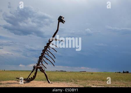 Alliance, Nebraska - A dinosaur sculpture on the Nebraska prairie. - Stock Photo