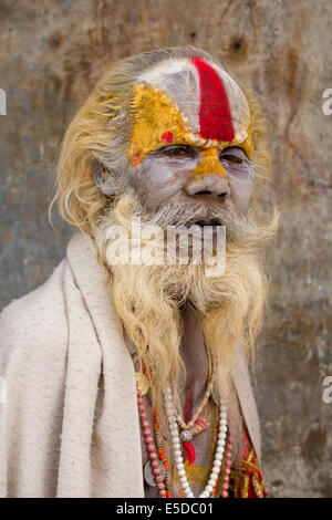 Portrait of a hindu sadhu (holy man) at the hindu temple complex of Pashupatinath, near Kathmandu, Nepal. - Stock Photo