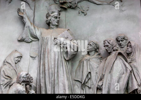 Relief from the main gate of the National Monument in Vitkov in Prague, Czech Republic. Jan Hus preaching in the - Stock Photo