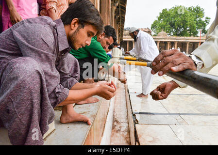 Ahmedabad, India. 29th July, 2014.  Muslims celebrating Eid al-Fitr which marks the end of the month of Ramadan, - Stock Photo