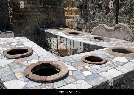 Thermopolium, former restaurant, kitchen, archaeological site, Herculaneum, Ercolano, Naples, Campania, Italy - Stock Photo