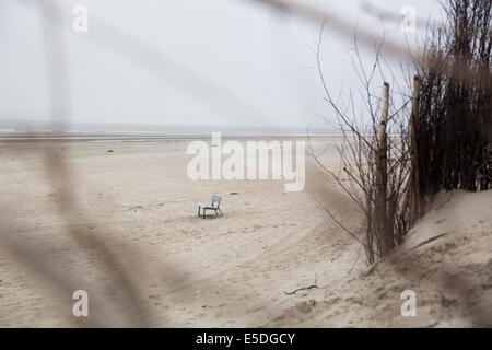 Germany, Lower Saxony, East Friesland, Langeoog, bench standing on the beach - Stock Photo