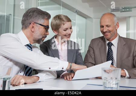 Germany, Munich, Businesspeople in meeting - Stock Photo