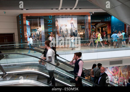 London July 2014. Westfield shopping centre. Escalator in front of Primark. - Stock Photo