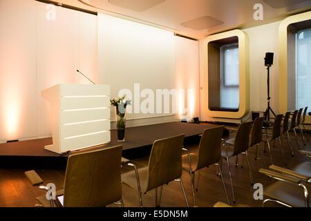 Empty auditorium and podium in a convention center - Stock Photo