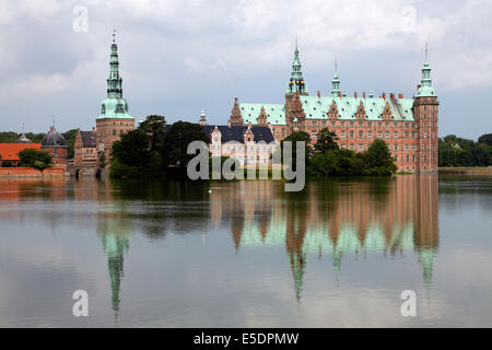 Frederiksborg Castle seen from the opposite bank of the Castle Lake - Stock Photo