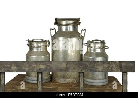 they three metal cans on milk on white background - Stock Photo