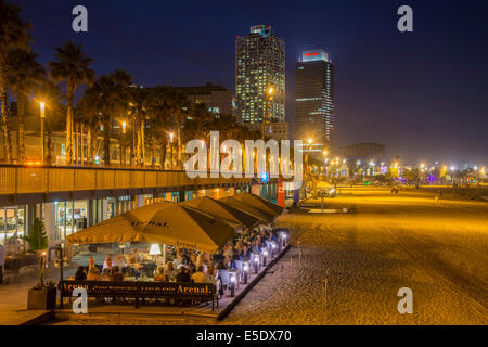 Night view over an outdoor restaurant on the sandy beach, Barcelona, Catalonia, Spain - Stock Photo