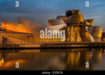 Guggenheim Museum at dusk, Bilbao, Basque Country, Spain - Stock Photo