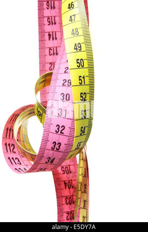Two measuring tapes isolated over white background - Stock Photo