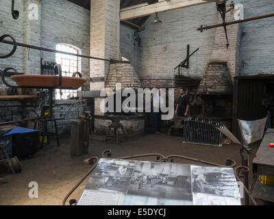 Two men working in the forge of National Waterways Boat Museum Ellesmere Port Cheshire home to nation's collection - Stock Photo
