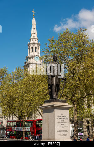 Statue of Major General Sir Henry Havelock on Trafalgar Square with St Martin in the Field Church behind. - Stock Photo