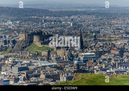 Views from Arthur's Seat in Holyrood Park across Salisbury Crags to Edinburgh Old Town including the Castle and - Stock Photo