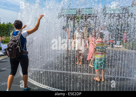 Amsterdam, Holland, The Netherlands, Tourists Cooling off in Public Garden Fountains during Summer Heat Spell, Urban - Stock Photo