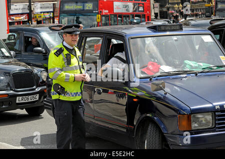 London, England, UK. Metropolitan police officers on duty during a taxi drivers' protest in central London, June - Stock Photo