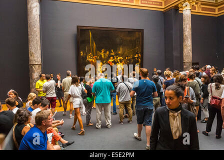 Amsterdam, Holland, The Netherlands, Crowd of Tourists Visiting Looking inside the Rijksmuseum, Museum, Looking - Stock Photo