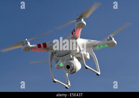 small unmanned helicopter with a camera floating in the sky Antarctica - Stock Photo