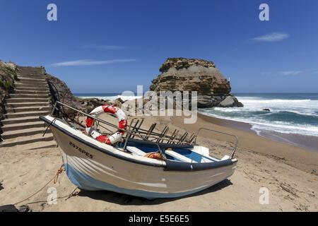 Small fishing boat on the beach Porto Novo Portugal - Stock Photo