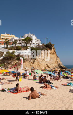 Sunbathing on Carvoeiro beach, Algarve, Portugal Europe - Stock Photo