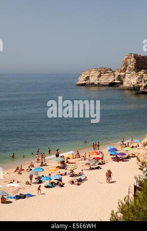 Tourists on Marinha Beach ( Praia da Marinha ) Beach view,  Algarve, Portugal, Europe in Summer - Stock Photo